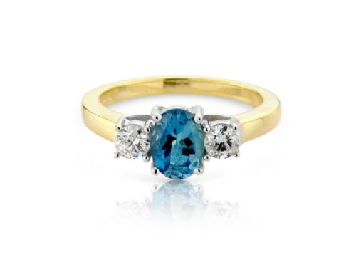 Yellow gold oval cut aquamarine and diamond trilogy ring
